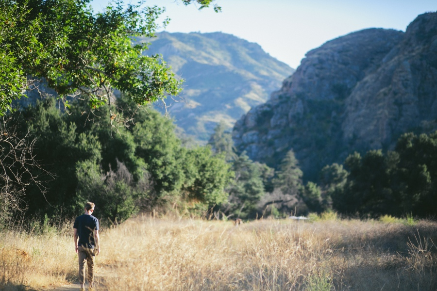 Wade Gasque walking on path in the mountains